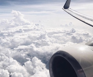 clouds, sky, and plane image