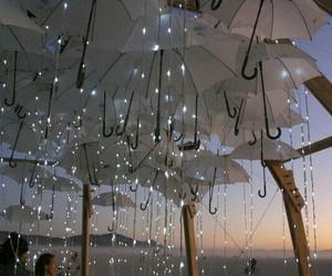 lights, umbrella, and beach image
