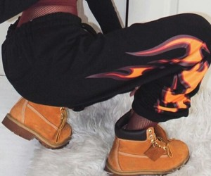 timberland boots, black sweatpants, and black crop long sleeve image