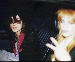 michael monroe, hanoi rocks, and razzle dingley image
