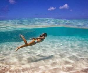 girl, swim, and ocean image