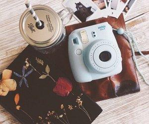 polaroid, books, and camera image