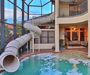 house, pool, and slide image