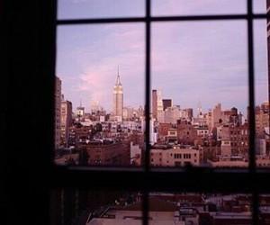city, sky, and window image