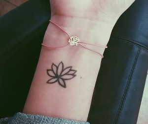 lotus flower, tattoo, and wrist tattoo image
