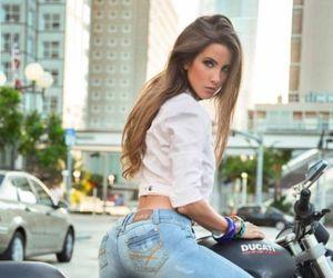 chica en moto image