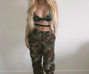 camo pants, black dr martens boots, and calvin klein bra image