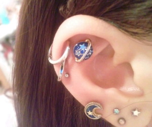 piercing, earrings, and planet image