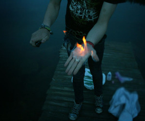 fire, boy, and hand image