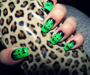 black, gree, and leopard image