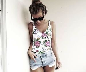 blouse, bun, and flowers image
