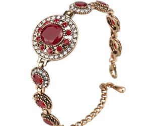 bracelets, earrings, and necklaces image