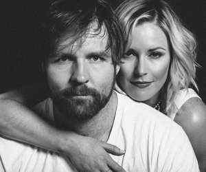 dean ambrose, renee young, and wwe image