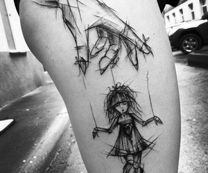 tattoo and doll image