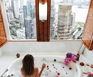 girl, bath, and flowers image