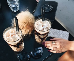 fur ball, sunglasses, and iced latte image