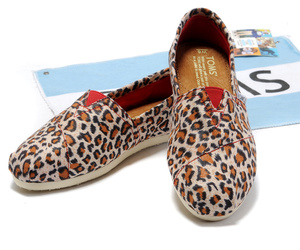 toms, cheetah, and leopard image