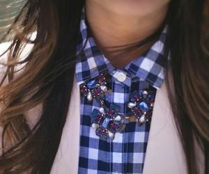 plaid shirt, statement necklace, and white blazer image