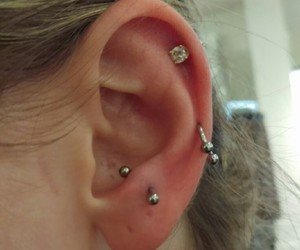 earring, piercing, and snug image