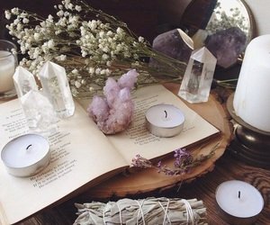 candle, crystal, and book image