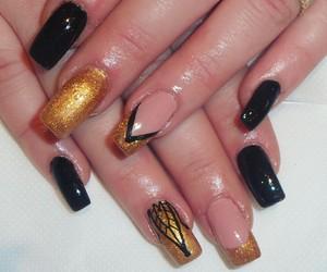 black, gold, and nail image