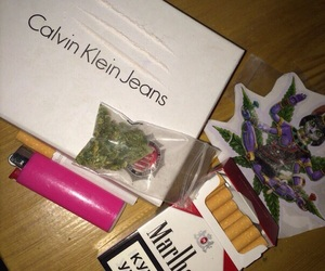 calvin klein jeans, cigarettes, and lighter image