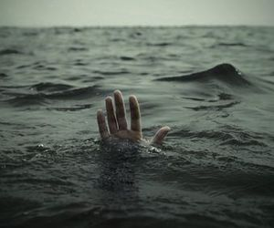 sea, hand, and water image