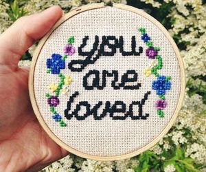 cross stitch, cursive, and floral image