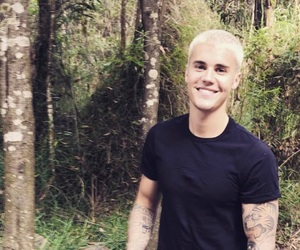 black t-shirt, blond hair, and JB image