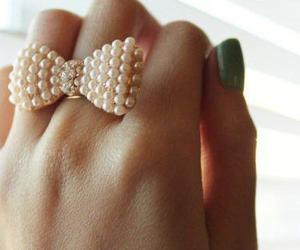 ring, bow, and pearls image
