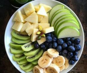 banana, blueberries, and kiwi image