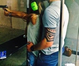 love, couple, and gun image