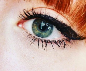 eyeliner, red hair, and eyes image