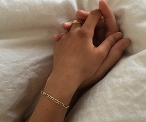 beige and hand holding image