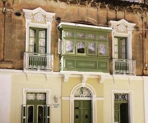 balcony, door, and facade image