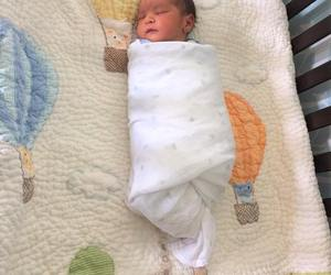 baby bibs, baby products online, and baby quilts image