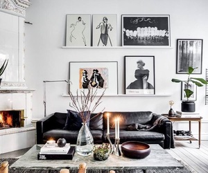 fireplace, paintings, and living room image