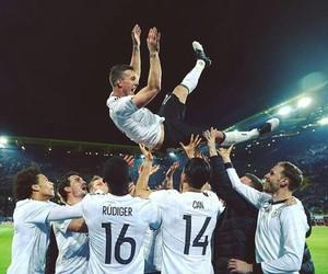 lukas podolski, bastian schweinsteiger, and german national team image