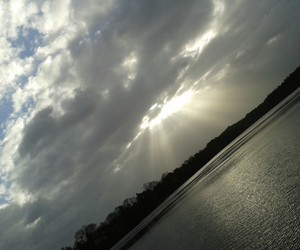 clouds, water, and sun shining image