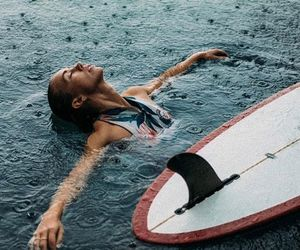 girl, rain, and surf image