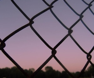 fence and sunset image