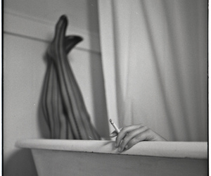 bathtub, black and white, and cigarette image