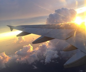 sky, sun, and airplane image