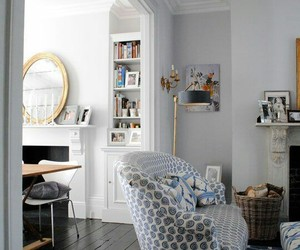home decor, blue and white upholstery, and black hardwood floors image