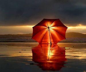 umbrella, sunset, and beach image