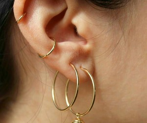 gold and earrings image