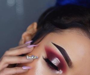 acrylics, false eyelashes, and makeup image