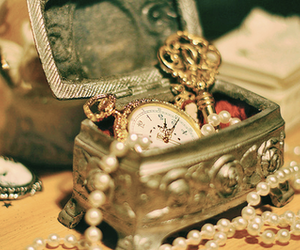key, pocket watch, and pearls image