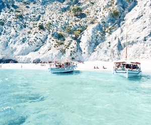 beach, blue water, and boats image