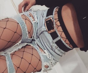 black belts, black fishnet tights, and light blue ripped jeans image